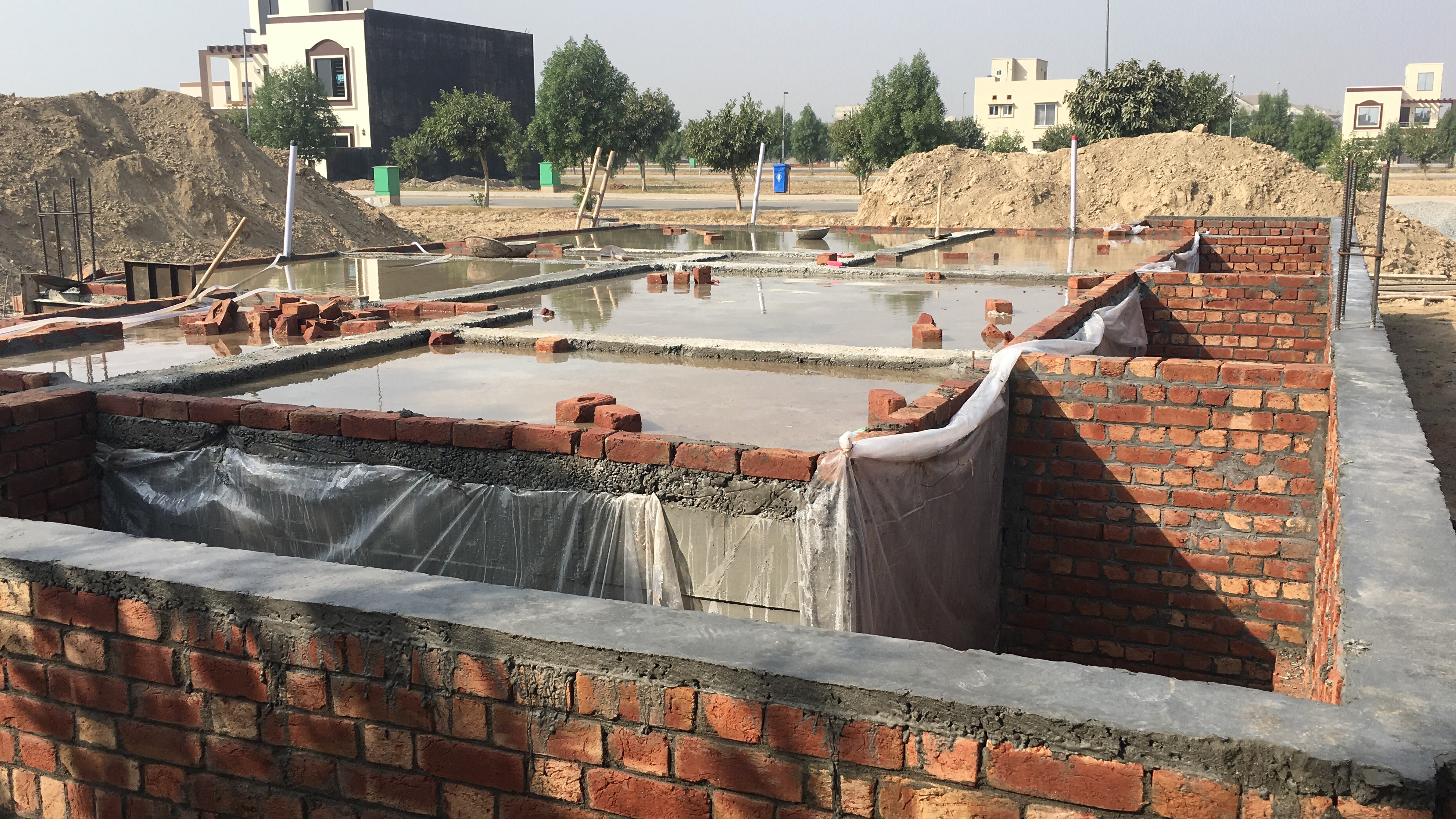 Basement construction cost grey structure pakistan for Basement foundation construction